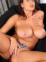 Sensual Jane strips down on a black couch