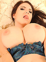 Busty babe Karina Heart stripping naked to show big tits