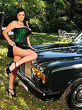 Busty Michelle Monaghan posing with a Rolls Royce outdoors