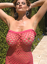 I am sassy. I think I'm pretty sassy in this here pink see-through top. Well, maybe more titty than sassy but it was a good attempt! I had to take some shots here with this green covered wall. I would love to have a backyard just like this one...